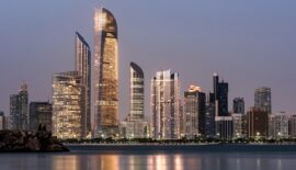 Abu Dhabi Seascape with skyscrapers in the background at evening